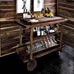 I might rip this off in order to have a decent bar in my apartment.  A cheap kitchen cart from ikea+a few pieces of pine shelving+a pretty stain = awesome.  I have a steel, 1.5 L container that I could use as an ice pail, though I wonder how hard/pricey it would be to integrate an electric ice maker w/o compromising storage space/style...