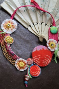 Fiber necklace with flowers, crochet and little shibori detail.