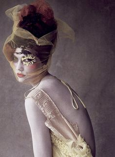 Karlie Kloss wears John Galliano in 'Feast for the Eyes' by Patrick Demarchelier for Vogue US, February 2010.