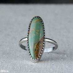 Each sterling ring has a genuine piece of long oval green turquoise. Beautiful and unique green turquoise with a rusty matrix, this is a unique and simple