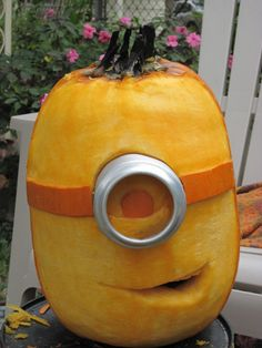 Who doesn't love a minion? These guys are one of my personal favorites. To create this look you'll need a few pumpkin shaving skills. Use an exacto knife to make a shallow cut to the areas you want to peel. Then carefully remove the orange skin part, leaving the soft flesh of the pumpkin intact.