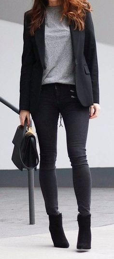 business lady wearing all black with grey details