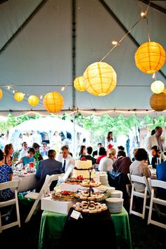 outdoor reception seating with dessert buffet and yellow golden chinese paper globe lanterns - photo by New Mexico based wedding photographers Twin Lens
