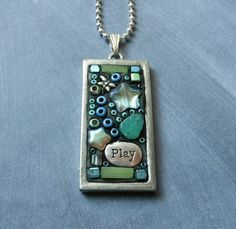 Come Play Silver Tone Mosaic Pendant. $18.00, via Etsy.