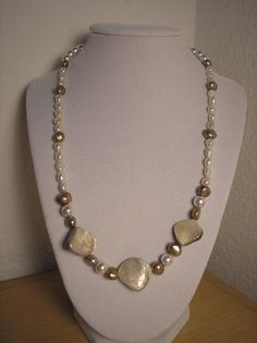 Genuine MOP shell nuggets/Genuine Freshwater pearls necklace. $14.75, via Etsy.