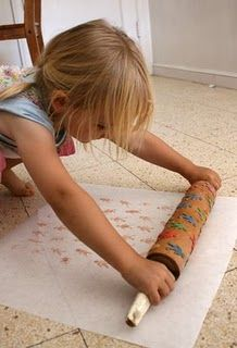 Make a fun print with foam stickers on a rolling pin.