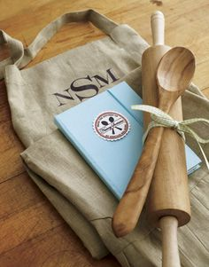 Love this gift idea. Monogrammed apron, rolling pin & spoon, & cookbook.