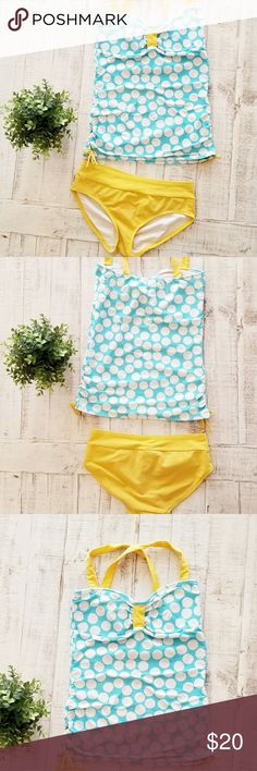 Polka Dot Lime Ricki Tankini Swimsuit How cute it this swimsuit! Lime Ricki white polka dot on turquoise with yellow bottoms! There are a few little snags on the top and faint marks on the bottoms, shown in last pictures, but nothing big! Top and bottom size medium  Fabric is 80% nylon 20% lycra Lime Ricki Swim