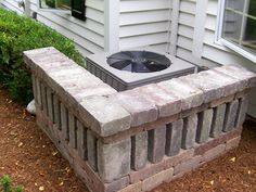 Air Conditioner Stone Screen. Interesting, and easy to build...only need to level the ground first!