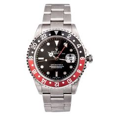 This gents Rolex watch features a ceramic rotatable red and black bezel and an extra 24-hour hand that completes one full rotation every 24 hours. #vintagewatch #rolex #chronograph #vintagerolex