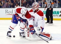 Montreal Canadiens defenseman Andrei Markov and goalie Carey Price combine to stop a shot against Boston Bruins during the second period of an NHL hockey game in Boston on Saturday, Oct. 22, 2016. (AP Photo/Winslow Townson)