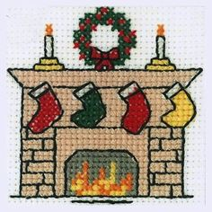 Christmas Cross Stitch Kits - A selection of cross stitch kits with a festive theme - perfect to stitch as a Christmas gift. Tiny Cross Stitch, Cross Stitch Stocking, Xmas Cross Stitch, Cross Stitch Cards, Cross Stitch Kits, Cross Stitch Designs, Cross Stitching, Cross Stitch Embroidery, Cross Stitch Patterns Free Christmas