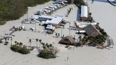 Floodwaters surround Gilbert's Resort in the aftermath of Hurricane Irma, Monday, Sept. 11, 2017, in Key Largo, Fla. (AP Photo/Wilfredo Lee)