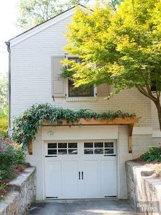 Details that soften and define can be a great way to give your garage a low- to mid-cost facelift without a lot of structural heavy lifting. One good option is a narrow pergola or horizontal trellis over the garage doors.