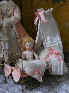 antique doll and bed