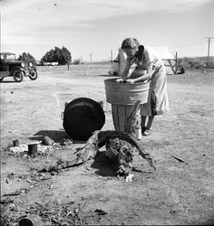 Circa 1937, Imperial Valley, California, near Calipatria. Laundry facilities in migratory labor camp. Dorothea Lange LC-DIG-fsa-8b31831