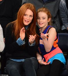 Her mini-me! Basketball fans were forced to do a double take when Julianne Moore and her looklalike daughter Liv attended the New York Knicks versus Minnesota Timberwolves game on Sunday