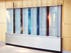 Saint John's celebrated the completion of their new campus with an elaborate donor recognition program that includes several different donor walls, a comprehensive history exhibit, and room-naming plaques. Colorful, textured art glass with religious and historical imagery is used throughout the program.