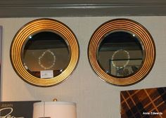Alexander Julian for Jonathan Charles: circular recessed mirrors.
