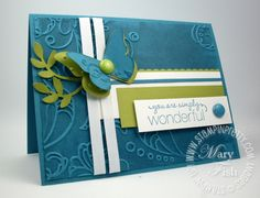 There is a tutorial for this card on Mary Fish's stampin up site. The card has a snazzy embossed background. Mary added VersaMark Ink to the inside of her Elegant Lines Textured Impressions Embossing Folder. WOW! Video Tutorial shows you the super simple procedure!