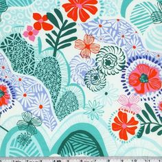 Flowers bloom in the foreground of a beautiful hilly landscape. This quilting weight fabric is 44/45