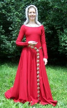 Lady's red cotehardie. Dressed in tight woolen cotehardie based on Herjolfsnes No.38. Woman wears white linen kruseler (headdress) and belt. Hand made. The late 14th century
