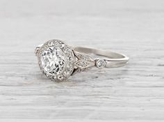 Vintage Edwardian J.E. Caldwell engagement ring made in platinum and centered with an approximately .75 carat EGL…