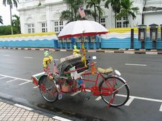 Trishaw decorated to catch the customer's eye.... Penang, Malaysia photo by jadoretotravel