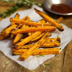 These Rosemary Sweet Potato Fries are absolutely DELICIOUS and they are baked, not fried, so you don't have to deal with a greasy mess! paleo and vegan