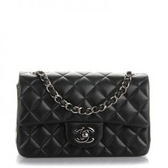 This is an authentic CHANEL Lambskin Quilted Rectangular Mini Flap in Black. The chic mini cross body classic is crafted of soft quilted lambskin leather in black.
