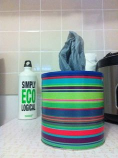Use an old coffee canister to hold plastic bags. Great recycling project.