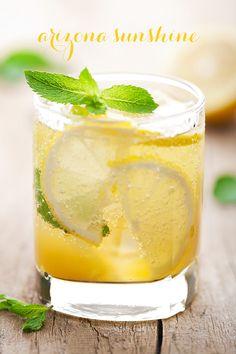 Arizona Sunshine Cocktail with Titos Vodka St Germain Prosecco Lemon