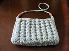 Crocheted purse.  This is a great dimensional shell stitch.  Fully lined with a zipper closure featuring one of my own polymer clay beads as a pull.