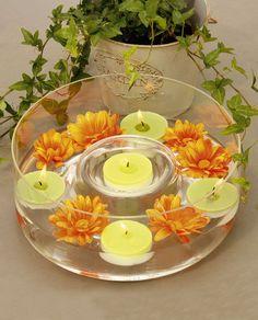 Flores y velas flotantes