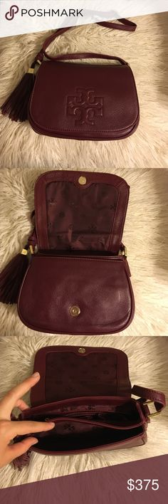 """Tory Burch Thea Saddle Bag Tory Burch Thea saddle bag in burgundy!  DETAILS: * Pebbled leather  * Shoulder strap, 24"""" drop. * Flap top with whipstitched trim and embossed Tory Burch double-T logo; magnetic snap. * Open pockets on front and back exterior. * Jacquard logo lining; one zip and two open pockets. * 6""""H x 9""""W x 3 1/4""""D No trades No lowballing ✅Bundle Discount  Authentic items  ✨purchase at listed price get a free gift✨ THIS ONE DOES NOT COME WITH TAGS BUT IT BRAND NEW NEVER USED…"""