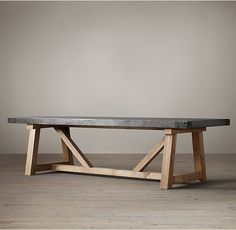 "RH's Salvaged Wood & Concrete Beam Rectangular Dining Table:Our table pairs a 3""-thick slate grey concrete top with the natural beauty of solid salvaged pine timbers from 100-year old buildings in Great Britain."
