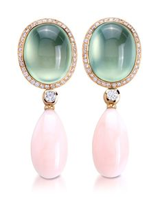 A pair of 18K yellow gold earrings, set with coral stone in the center and diamonds around.