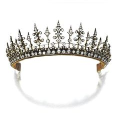 A variation on the fringe tiara, 1890, in some ways similar to that often worn by Princess Madeleine of Sweden. This piece can also be used as a necklace; Featuring at least nine higher diamond floral pinnacles, with smaller spacers, and a diamond open-work base. Sold via Sotheby's in 2008, for $22,500.