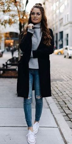 trendy outfit idea : black coat + sweater + rips + sneakers