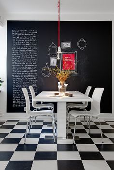 Writing on the wall ... some very cool ways to incorporate it into your decor.   I'd love to try the one below featuring the names of various authors, it's so perfect in that space.