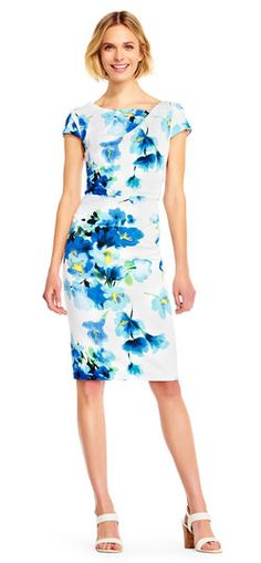 Pretty poppies bloom across the crepe fabric of this short sleeve dress for a bright, cheery look. This sheath dress features a fitted design, watercolor floral print, a v-back and a draped neckline. A hidden zipper at the back closes this day dress. The crepe fabric has a slight stretch for a comfortable all day style. This dress loves to attend days at the office and day occasions alike!