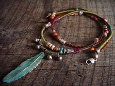 Brass Feather and Glass Beaded Necklace by yuccabloom on Etsy, $50.00