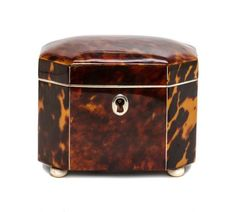 An English Tortoise Shell Tea Caddy, of octagonal form, having a hinged lid opening to a single drawer. Height 3 1/2 x width 4 x depth 2 3/4 inches.