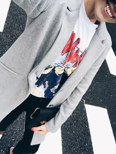 Throw a structured blazer over a graphic tee.