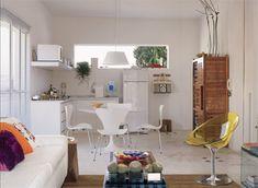 Cozinha pequena, só o essencial. Na falta de espaço, as prateleiras acomodam o microondas. Ideal para casal ou para quem mora sozinho. Detalhes: o piso é o mesmo, o que aumenta a sensação de amplitude. O tapete define o living.