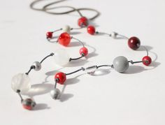 Hey, I found this really awesome Etsy listing at https://www.etsy.com/listing/153977505/wooden-bead-necklace-boho-red-grey-white