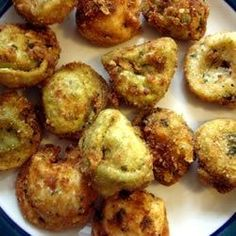 """Tia and David's Deep Fried Tortellini   Real party pleasers, these cheese tortellini are shaken up with bread and cornflake crumbs, then deep-fried to a mouth-watering golden brown. Try them dipped in tomato sauce!"""""""