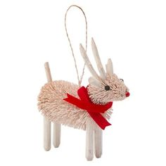 "This wee forest friend is right at home on any holiday tree. Our darling Reindeer Buri Ornament friend is crafted from natural Buri fibres and sports a red velvet scarf that lends it a festive charm. It comes ready to hang with a twine loop. 4.75"" tall. Buri, wire, rattan, driftwood, velvet, paint, beads. Available only at Indigo."