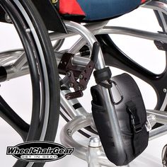 Wheelchair Accessories No-Slip Grip-Clip. The No-Slip Grip-Clip is a wrap around strap with a strong aluminum spring activated caribiner clip that helps you carry stuff on the front tubing of your wheelchair with-out sliding down your wheelchairs frame. CLICK HERE http://www.wheelchairgear.com/product/no-slip-grip-clip/