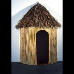 Cover last year's fiesta house with bamboo and add grass skirt to roof?